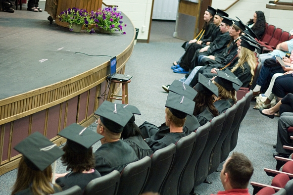 Graduates watching ceremony