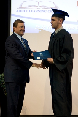 Male graduate receiving diploma