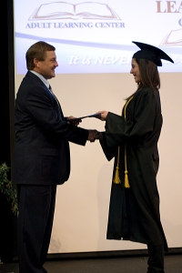 Female graduate receiving diploma